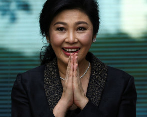 Thai ex-PM Yingluck misses verdict, arrest warrant issued: judge