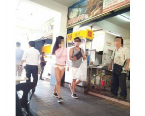 Woman walking around in bikini bottoms sparks hot discussion in Sabah