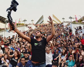 Social media star Nas famed for his 1-minute travel videos draws a crowd in Singapore