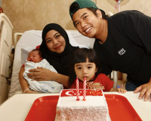 Couple welcome their second National Day baby at stroke of midnight