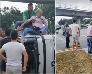 Food delivery rider rescues elderly driver from lorry that flipped on its side