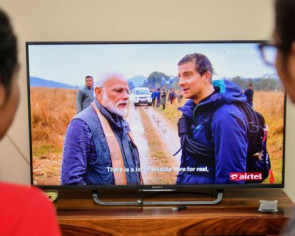 India's Modi bears all, sniffs dung with Grylls