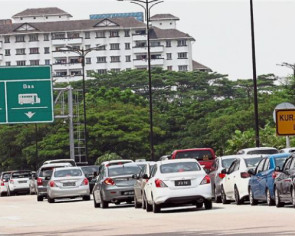 Stricter security inspections in Singapore lead to massive congestion at checkpoints