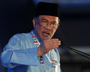 Anwar will cooperate with police over sexual misconduct allegations
