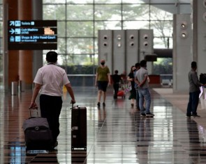 Singapore to tighten border restrictions for visitors from Hong Kong from Dec 14