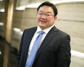 Jho Low should come back to Malaysia if he has the coronavirus, police chief says