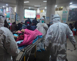 Coronavirus: Wuhan doctors battle outbreak in diapers as masks rub their faces raw