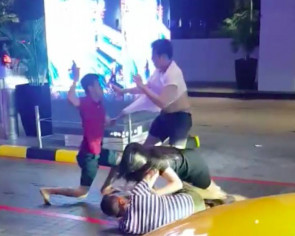 Backflip, torn shirt and vulgarities during fight involving 1 woman, 3 men outside MBS casino