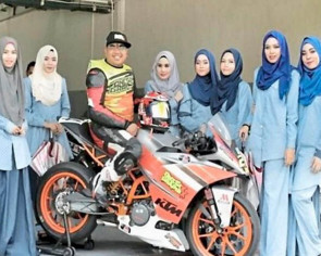 Tudung-clad grid girls turn heads at bike race in Malaysia