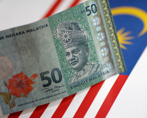 Malaysian ringgit hits 4-month low on market re-opening after Mahathir's shock election win