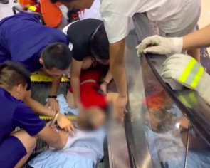China mum panics as 2-year-old son gets entire arm sucked into escalator