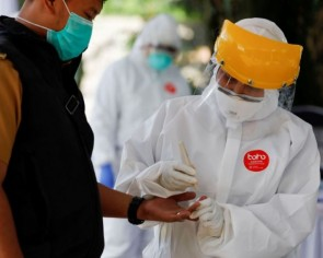 Widespread use of rapid tests in virus-stricken Indonesia raises questions