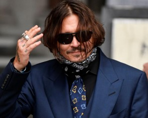Johnny Depp wrote in blood from severed finger during row with ex-wife, court told