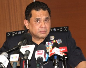 Go for second Covid-19 test or else, Malaysia cops warn returnees