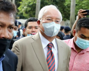 Former Malaysia PM Najib sentenced to 12 years jail, fined $68m for abuse of power