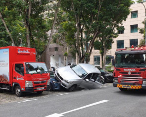 BMW driven by elderly woman crashes into and mounts cars at carpark near Wheelock Place