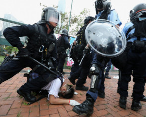 In Hong Kong protests, did police use excessive force or issue a proportional response?