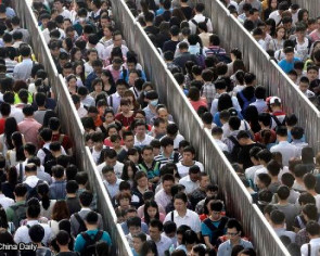 Beijing to keep population down