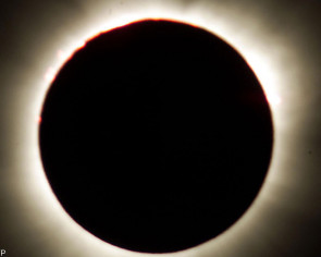 Seeking the dark, eclipse junkies head for the Arctic