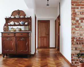 Personal collection of vintage furniture gives couple's 5-room flat an old-school charm