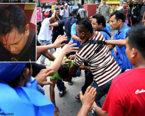 Bomb squad locked in school as supporters clash at Permatang Pauh by-election