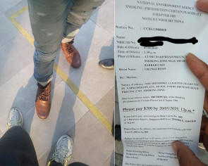 Man claims he was fined $200 with only one foot outside smoking area, NEA says he was outside