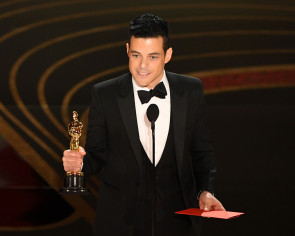 Best Actor Oscar-winner Rami Malek treated by paramedics after tumbling off stage