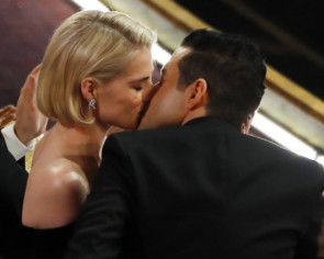 Rami Malek and Lucy Boynton show PDA at the Oscars
