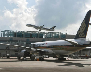 SQ mid-air bomb hoax: Mumbai-Singapore flight escorted safely to Changi, woman and child questioned