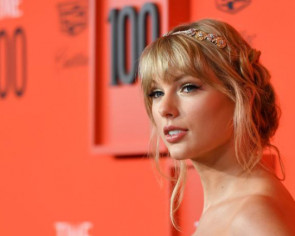 Taylor Swift says songwriting her 'protective armour'