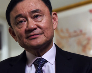 Thai military strips Thaksin of award, calls for 'good people' to govern