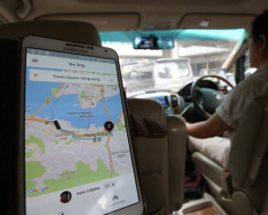 Uber eyes headquarters move to Hong Kong - provided city first changes regulations to legalise service, source says