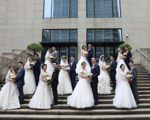 Historic hotel in China holds mass ceremony for medics delaying weddings