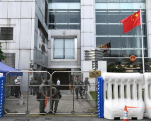 China sets up Hong Kong crisis centre in mainland, considers replacing chief liaison
