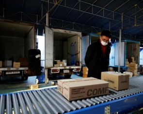 South Korean delivery workers say coronavirus boom means relentless toil