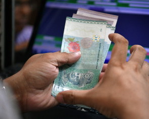 Malaysia's central bank governor says ringgit is not fairly valued