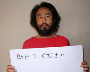Abe 'relieved' at Japanese hostage's release but wants to confirm identity