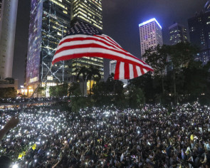 Hong Kong protesters take over park and roads to support US democracy act