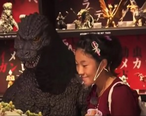 Japanese girl achieves lifelong dream by going on a date with Godzilla