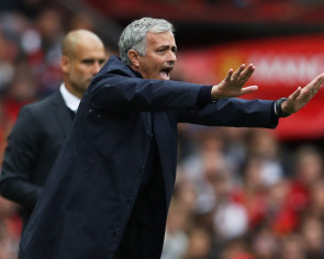 Football: Mourinho feels heat as Wenger marks anniversary