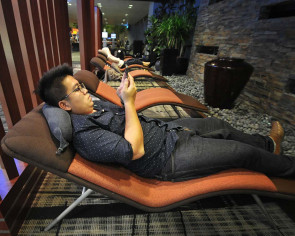 Is sleeping in transit lounges as comfortable as staying in a hotel?