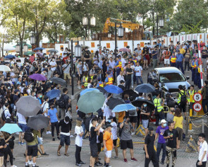 Riot police to rescue as Hong Kong protesters trap minister in his car