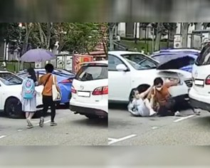 Car reverses into parking lot near Bukit Timah Food Centre, hits woman and child