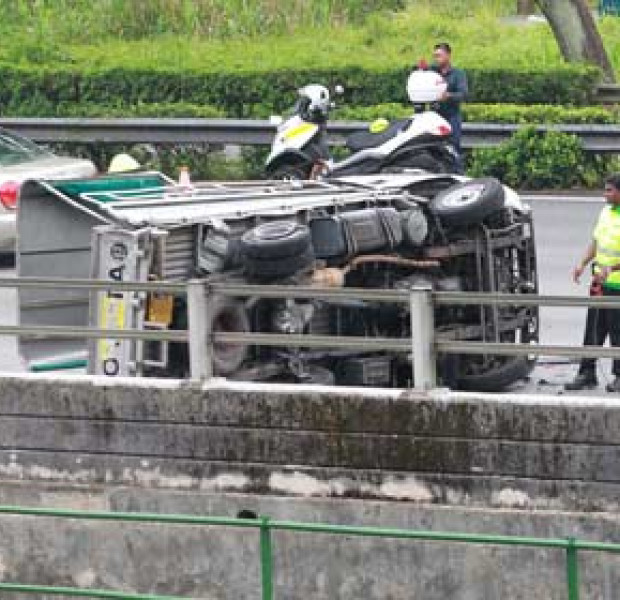 Father & son rescue man flung into canal after lorry crash