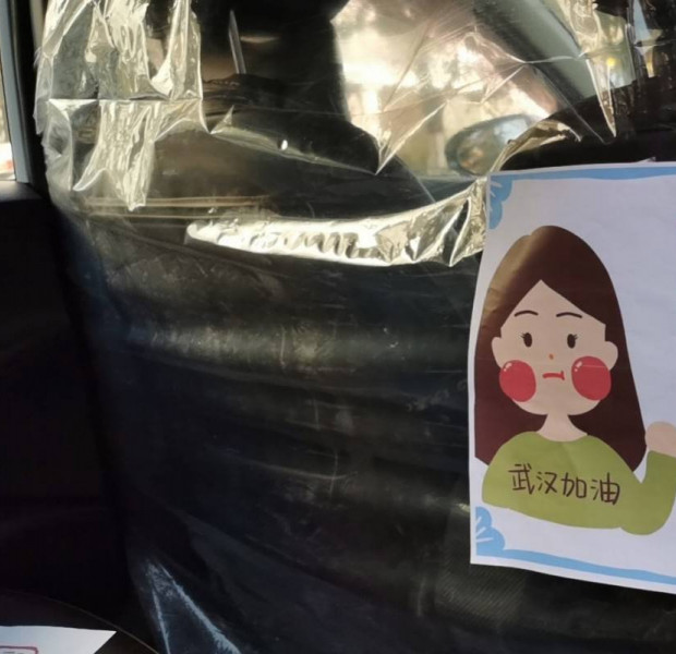 Chinese ride-hailing service puts plastic dividers in cars to help stop coronavirus spread