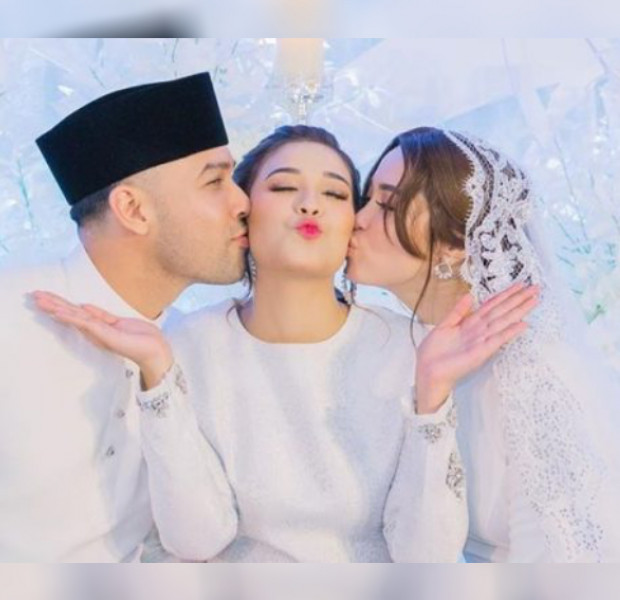 Photo of Malaysian celebrity wedding day kiss goes viral