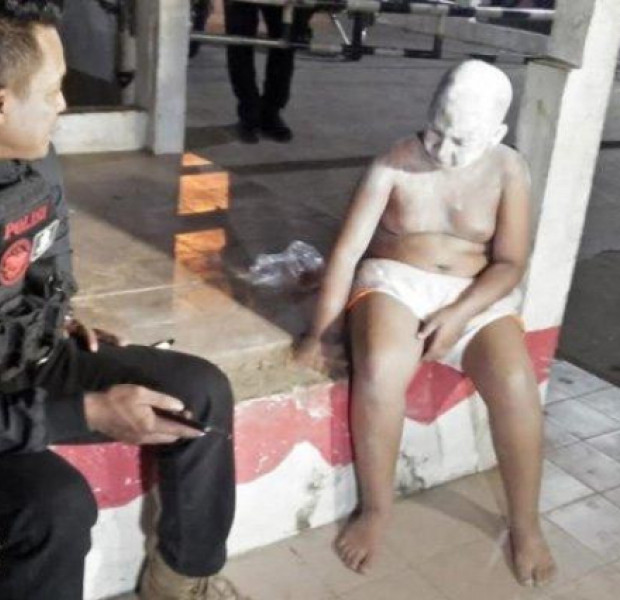 Indonesian police scold boy pretending to be 'ghost' for YouTube