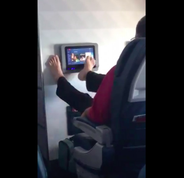 Video of man using foot to swipe in-flight screen leaves Twitter users toe-tally disgusted
