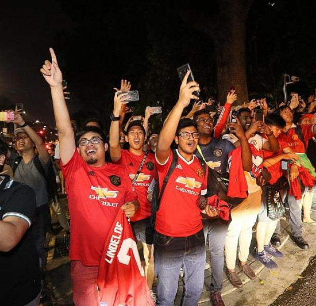 Fans in Singapore see red over the cold Red Devils