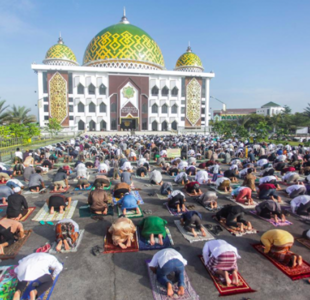 Indonesian Muslims perform Eid prayers with social distancing, masks
